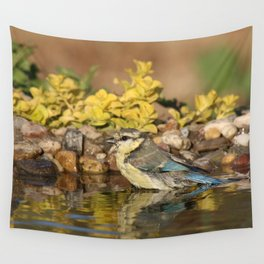 young bird bathes Wall Tapestry