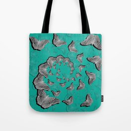 A swirl of gray butterflies on teal background Tote Bag