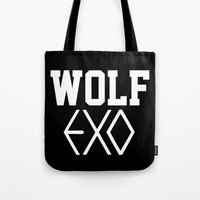 exo Tote Bags featuring EXO  Wolf by Sara Eshak