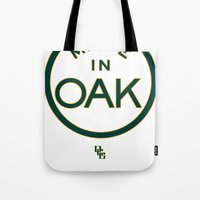 oakland Tote Bags featuring Made in OAK - Oakland A's by DCMBR - December Creative Group