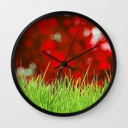 Green Grass and Red Crimson Background Wall Clock