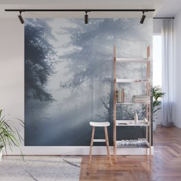 Sun rays shinning through foggy forest Wall Mural