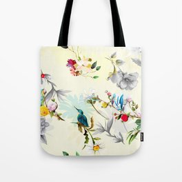 Red flowers, leaves and birds around on light yellow Tote Bag