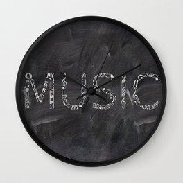 Music typo on chalkboard Wall Clock