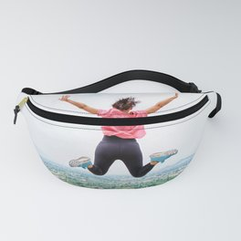 healthy sport woman jumping against cityscape Fanny Pack