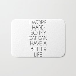 I work hard so my cat can have a better life Bath Mat