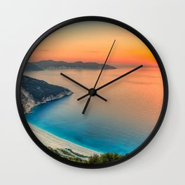 The sunset at the famous beach Myrtos in Kefalonia island, Greece Wall Clock
