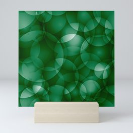 Dark intersecting green translucent circles in bright colors with a grassy glow. Mini Art Print