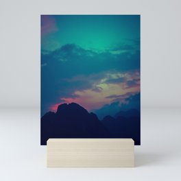 Blue and pink evening sky over the limestone mountains in the Vang Vieng province in Laos. Mini Art Print
