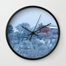 Red house lost in a snowy storm Wall Clock