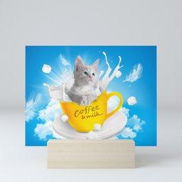 A cat in a coffee and milk cup Mini Art Print