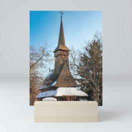 Traditional Romanian wooden Church covered in snow Mini Art Print