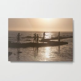 Children playing on the beach, silhouetted at dusk Metal Print