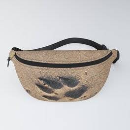 Dog paw prints on a sandy beach Fanny Pack