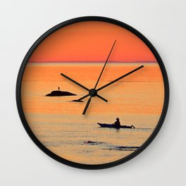 Kayak and Birds under Orange Skies Wall Clock