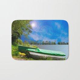 two boats at a lake Bath Mat