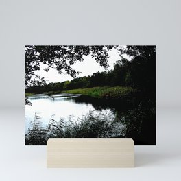 Riverside with trees and reed photo Mini Art Print
