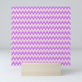 Simple chevron pattern shaded from vivid magenta to pale yellow Mini Art Print