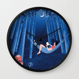Reading alone in the woods at night Wall Clock