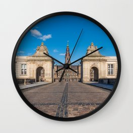 Entrance of Christiansborg Palace under a blue sky on a sunny day Wall Clock