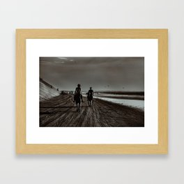 Young Couple Riding Horses at the Beach Framed Art Print