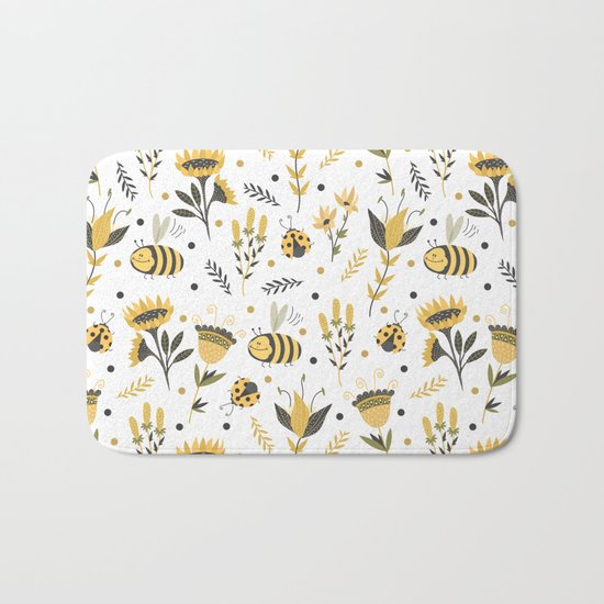 Bees and ladybugs. Gold and black Bath Mat