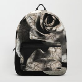 Rose forming from light and shadows Backpack