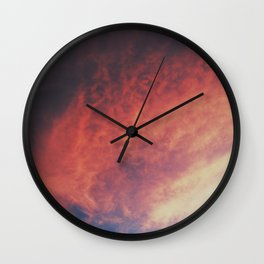 devilish skies Wall Clock