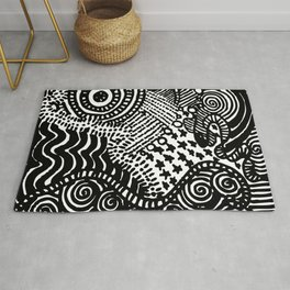city by the sea Rug