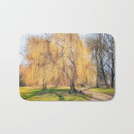 Weeping willow tree in a park Bath Mat