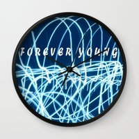 forever young Wall Clocks featuring forever young by Bunny Noir