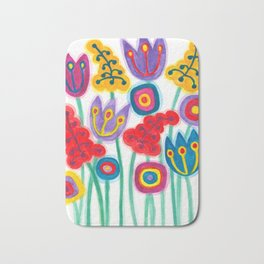 raw flower garden with tulips Bath Mat