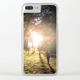 Woman hiking along an Oregon forest trail at sunset Clear iPhone Case