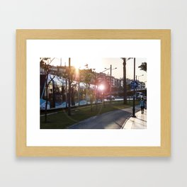Tram running between the street and the walking path in Izmir Framed Art Print