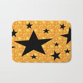 balck star and orange spiral Bath Mat