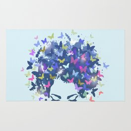 Woman with the hair made of butterflies Rug