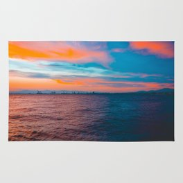 Colorful sea in the night with industrial port Rug