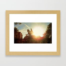 Sun behind Framed Art Print