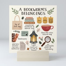 A Bookworm's Belongings Mini Art Print