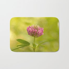 Red clover on green blur nature background #decor #society6 Bath Mat