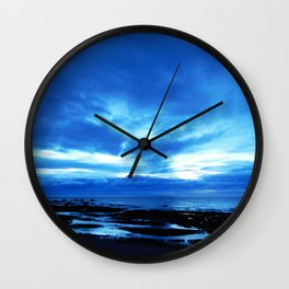 Arm from Above Plays with the Sunset Wall Clock