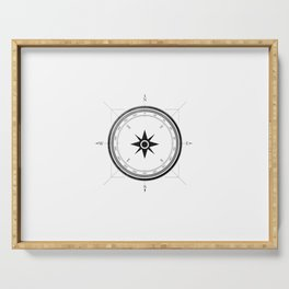 Black Compass on White Serving Tray
