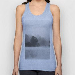 Trees disappearing in morning fog above the lake Unisex Tank Top
