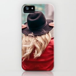A young woman wearing a hat is walking in the streets of New York City iPhone Case