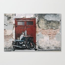 Boy on a Bike Canvas Print