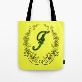 the letter F in a leaves and flowers . Art Tote Bag