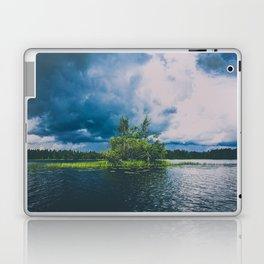 tree island on a stormy lake Laptop & iPad Skin
