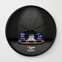 f1 Wall Clocks featuring 1995 McLaren F1 GTR Le Mans - Gulf Livery by vsixdesign