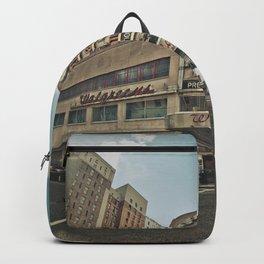 PEOPLE WALKING NEAR BUILDINGS DURING DAYTIME Backpack