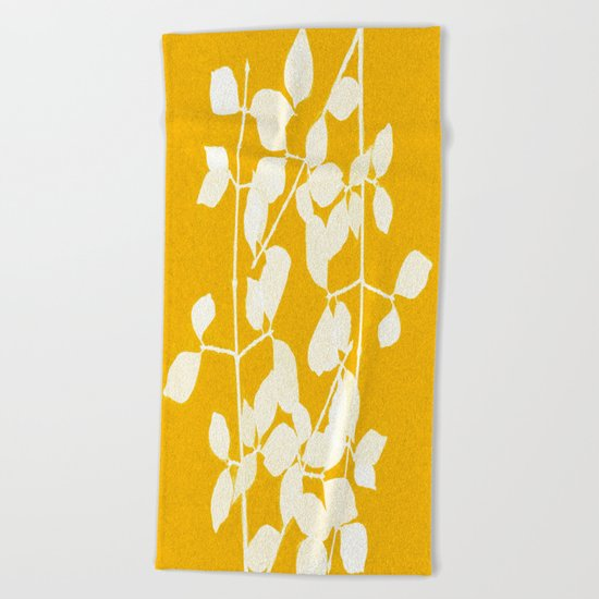 white branch on golden tone Beach Towel